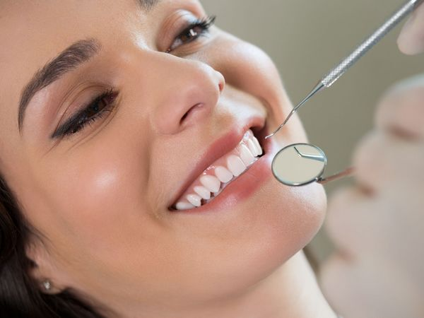 Young woman on a Teeth cleaning session